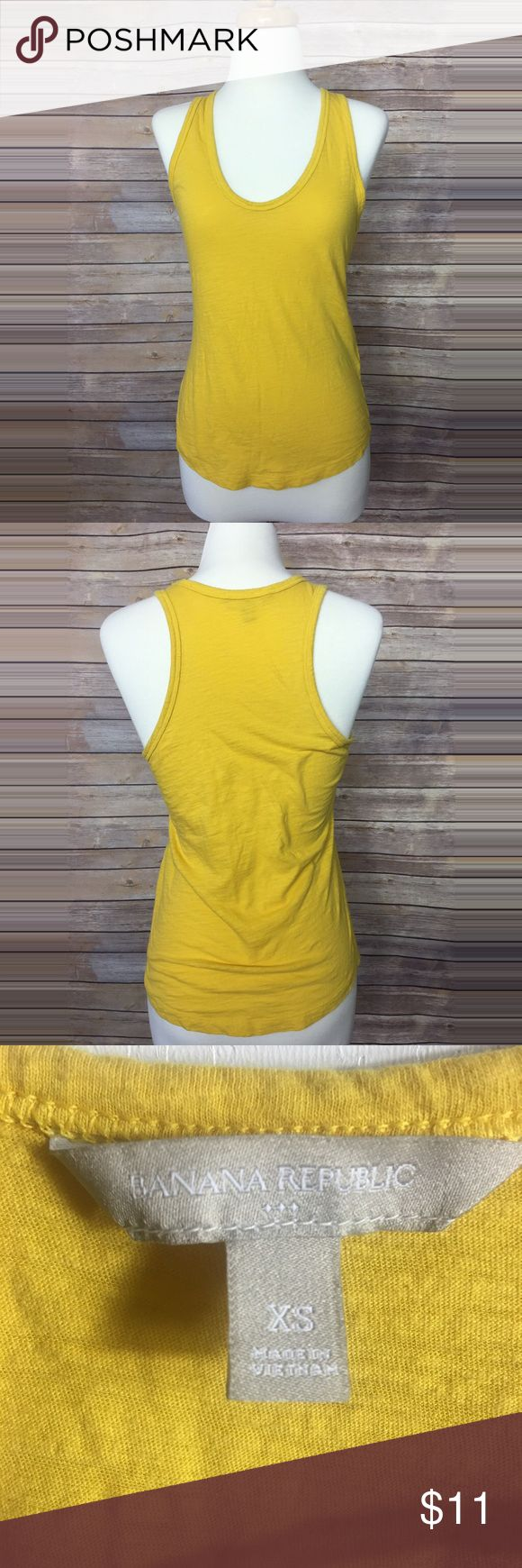 Banana Republic yellow tank top Cute little yellow Banana Republic tank top. Super stretchy and comfy. Gently used. No rips tears or stains. Measurements are Bust: 17in  Lenght: 23in Banana Republic Tops Tank Tops