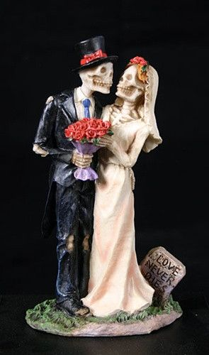Two skeletons prepare for marriage for all eternity in this Love Never Dies Skeleton Wedding Cake Topper. It suggests themes ranging from gothic inspired, day of the dead, spooky Halloween skeletons..