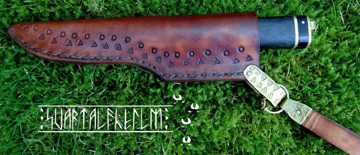 knife in hand stamped lether scabbard.
