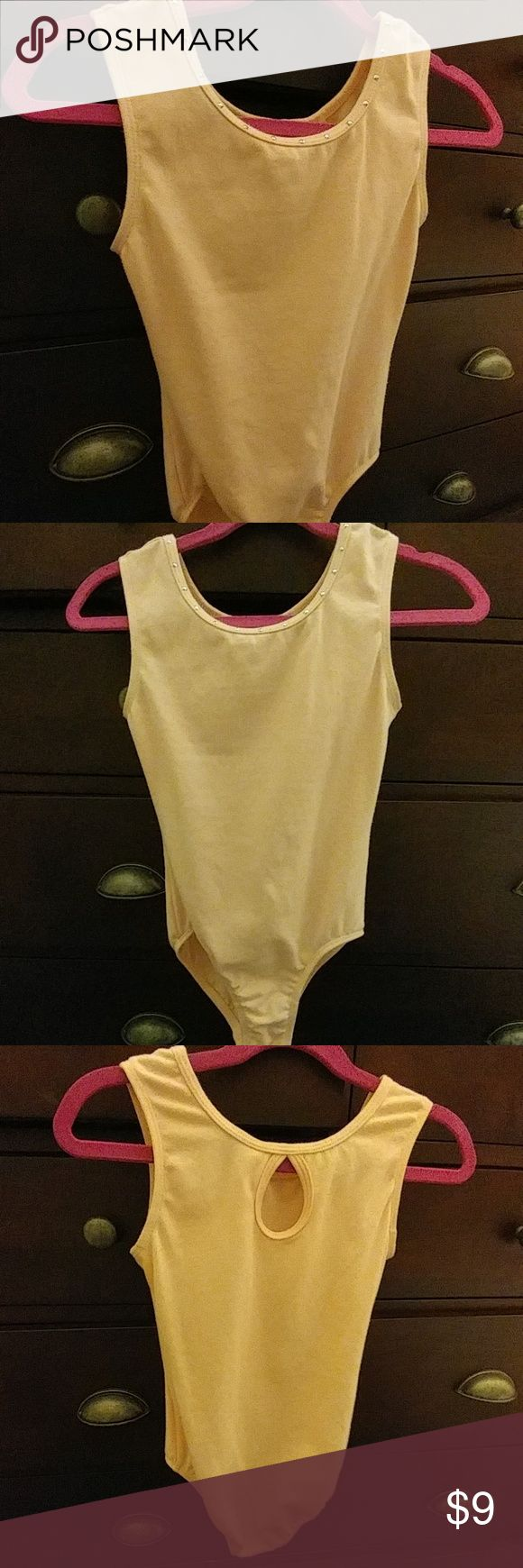 Danskin freestyle ballet pink leotard Kids 6/6X Very light wear.  No stains.  Color is ballet pink/pale pink.  True to size.  Small rhinstones like grommets across neckline (intact and not loose).  Keyhole back. No buttons or clasps. Always hand washed, dry flat.  Smoke/pet/perfume free home. Danskin Costumes Dance