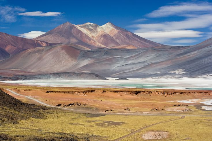 """San Pedro de Attacama, Bolivia. The nearby lakes filled with Flamingoes is breathtaking. We rode to the """"Valley of the moon"""" while here and it was amazing! Each turn was somewhere that looked totally different."""