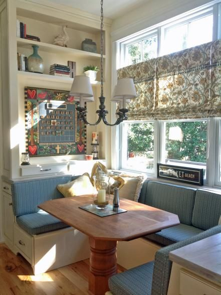 """If you're selecting a more standard-shaped table for a tiny dining nook, interior designer Gina Fitzsimmons, ASID, advises you choose one with a pedestal base so people can easily slide in and out of their seats. Another tip: """"For maximum space efficiency, the table should overlap the seat by just one inch,"""" she recommends."""
