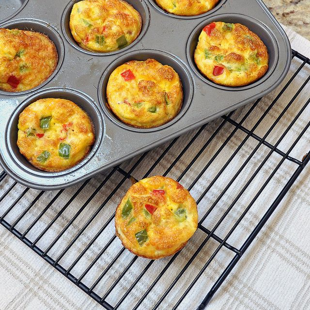 EGG BREAKFAST MUFFINS  10 large eggs      1/2 cup mozzarella cheese      1/2 scant cup diced green and red peppers      salt and pepper to taste    Pre-heat oven to 375 F.    Spray muffin pan with cooking spray.    In a medium size bowl mix all ingredients together. Pour egg mixture into muffin tins, about 3/4 full.    Bake for about 25 minutes, or until a light golden-brown.