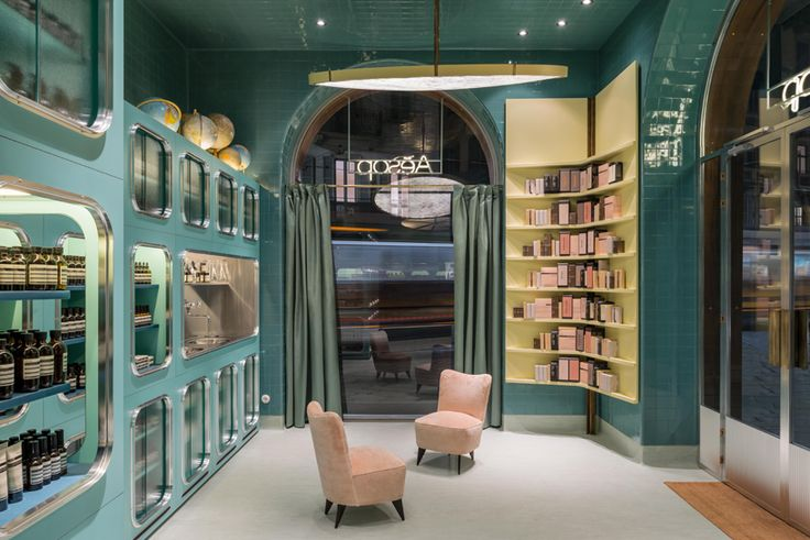 glossy teal tiling and display cabinets provide a characteristic backdrop to the skincare brand's second boutique in milan.