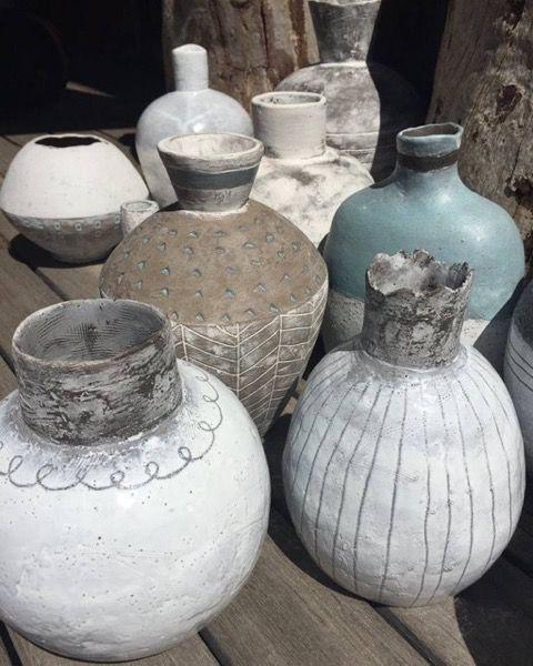 Pots after a low glaze firing