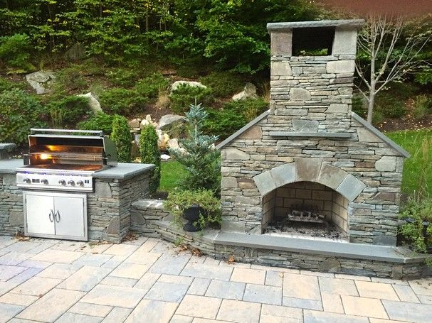 """36"""" Standard outdoor fireplace with natural stone veneer sits alongside a TLR 38"""" stainless steel grill--the perfect combination."""