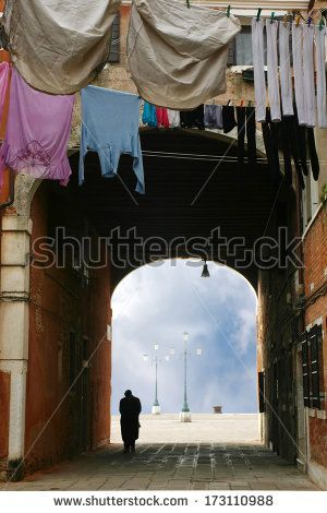 lonely man walking in typical #calle of #Venice - stock photo #shutterstock