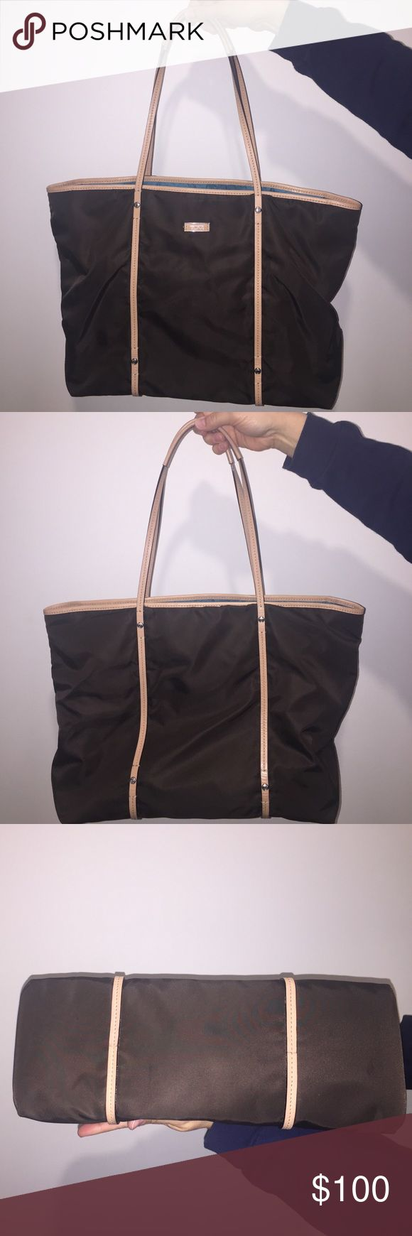 Tumi nylon tote Very good condition.  Barely used.  No marks or stains.  Non-smoking household. Tumi Bags Totes