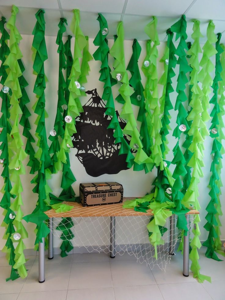 make vines out of plastic tablecloths; cut a V on alternating sides of strips of the table cloth