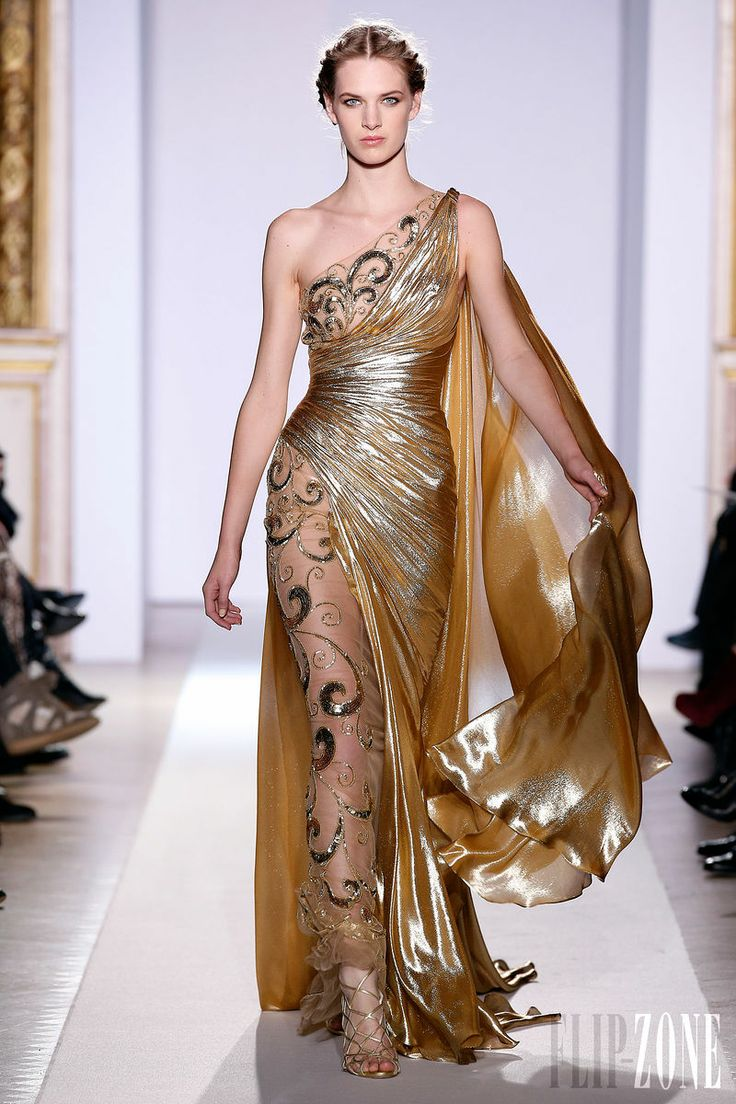 Zuhair Murad - Couture - Official pictures, S/S 2013 - http://en.flip-zone.com/fashion/couture-1/fashion-houses/zuhair-murad-3366 - Long dress in gold chiffon, asymmetrical draping and assorted panel enhanced with gold baroque arabesques.