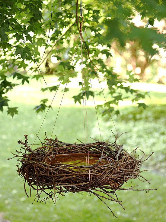 DIY - bird bath using shallow ceramic bowl, grapevine wreath, copper wire