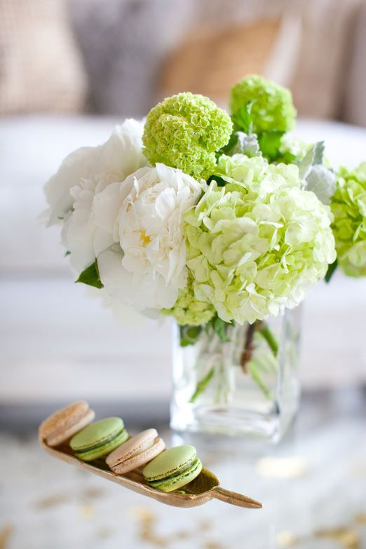 White peony's and pistachio macarons - I love this idea of using pastel macarons to decorate the table