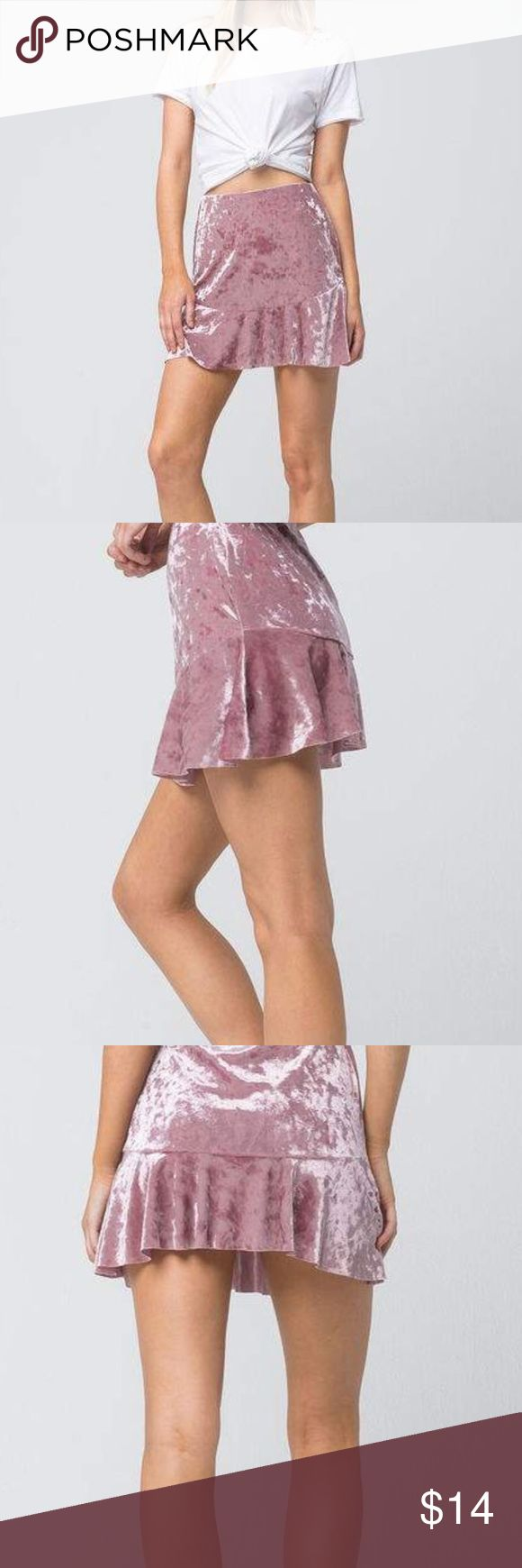"""Mauve Socialite Velvet Fit and Flare skirt. Socialite Velvet Fit and Flare skirt. Crushed velvet skirt with an elasticized waist. Tiered hemline with a ruffled bottom. Raw edge trimming. Approx length: 15"""". 97% polyester/3% spandex. Hand wash. Made in USA.Model is wearing a size small. Model measurements:Height: 59 Bust: 32Waist: 23Hips: 34 Socialite Skirts Mini"""