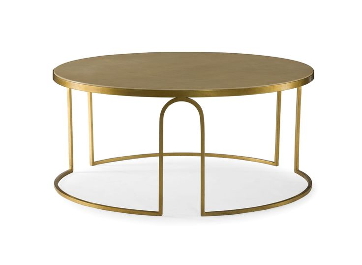 A transitional round coffee table, featuring a cream faux vellum top and an art deco inspired gold leaf steel base. #interiors #black #gold #christmas #andrewmartin #table