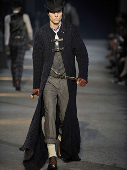 Love the tweed, the chain, the pants rolled up, the long johns underneath that show low. Love the way the sweater clasps, just would like to see sweater slightly shorter.