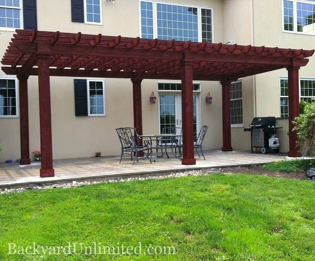 12'x24' Artisan Wood Pergola with Mahogany stain and wood posts http://www.backyardunlimited.com/pergolas.php