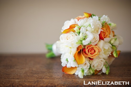 of white and orange with roses calla lilies sweet peas and peonies