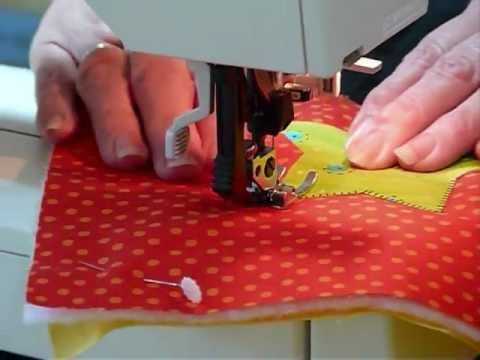 This videos shows a method of making a Quilt as you Go block with some fused applique and machine quilting, great for using up fabrics and batting.