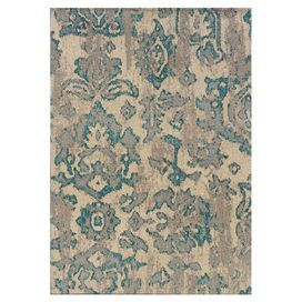 Stylishly anchor your living room or master suite with this alluring woven rug, showcasing a distressed botanical motif.    Product: RugConstruction Material: PolypropyleneColor: Ivory and blueFeatures: Machine-woven in EgyptNote: Please be aware that actual colors may vary from those shown on your screen. Accent rugs may also not show the entire pattern that the corresponding area rugs have.