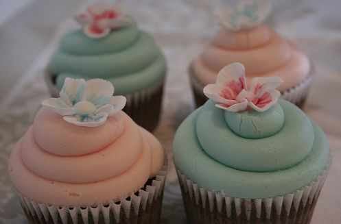 Chocolate cupcakes with peach and aqua-hued swiss meringue buttercream (dessert table)