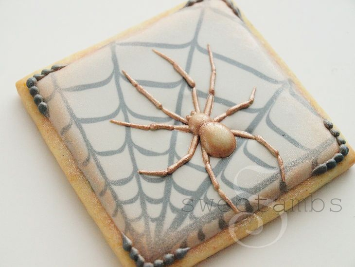 Tutorial for creating these spectacular spider and web Halloween cookies.