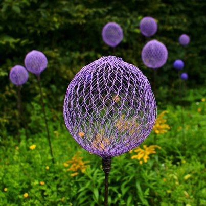 Painted chicken wire balls for your garden. What about painting them with glow-in-the-dark paint??? Could look neat at night. More