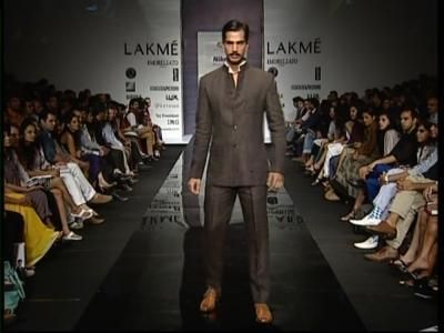 """RR sayd - """"A linen Bandhgala suit has its charm, keeping it elegant and yet so fashionable. Call Parul at our office she is an expert in suggesting the best looks for you or a friend."""""""
