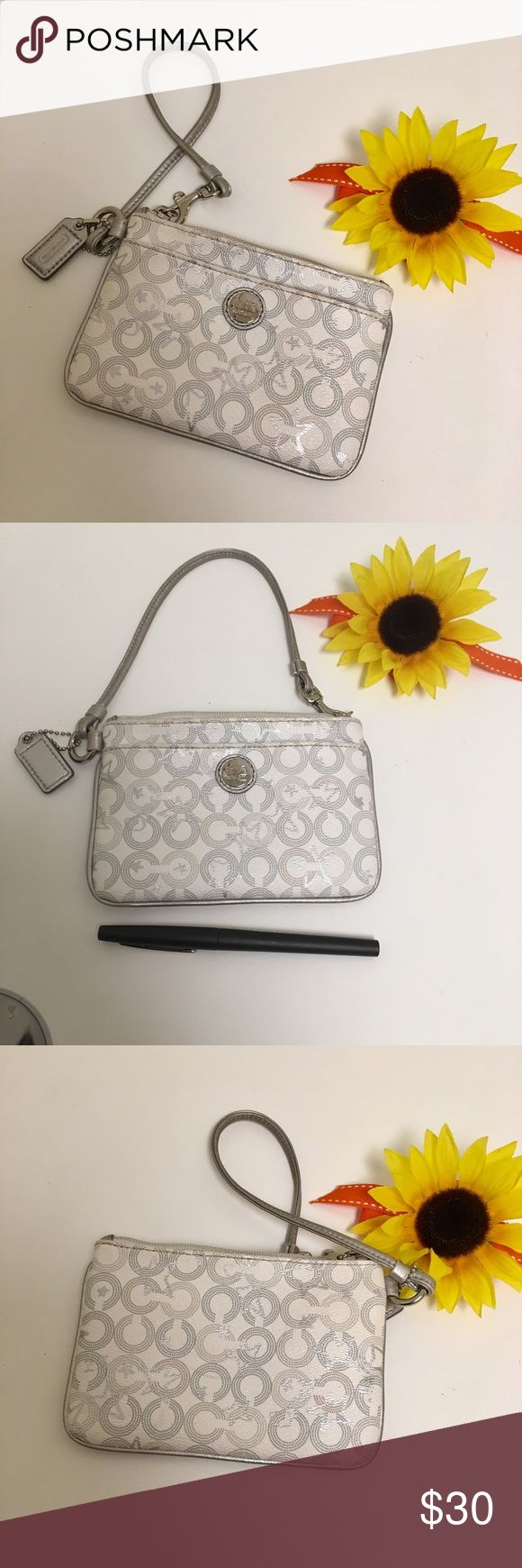 Coach wristlet Off-white Coach wristlet with silver stars and Cs. Has outside pocket.  EUC.  Lining is satin grey.  Great for cash, ID, lipstick! Coach Bags Clutches & Wristlets