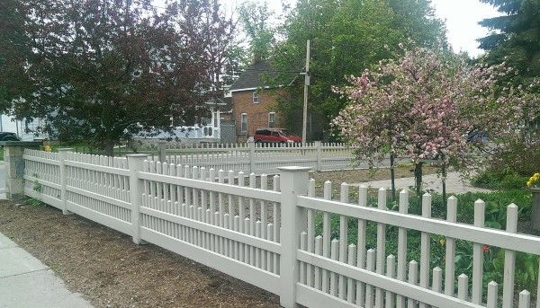 A Modern Picket Style Fence Provides An Attractive