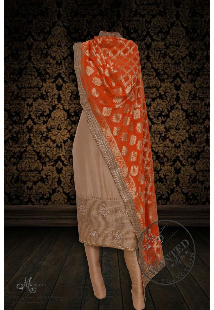 Captivating golden suit adorn in rich hand work complemented with benarasi dupatta