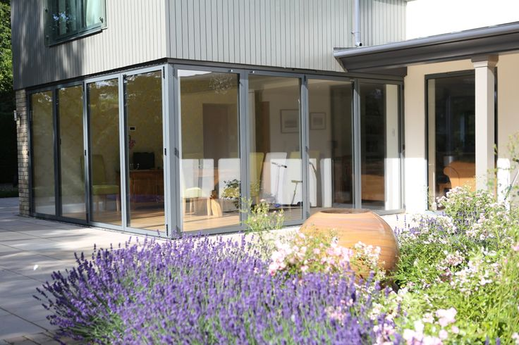 Remodelled home with sliding folding doors opening back from a corner post.