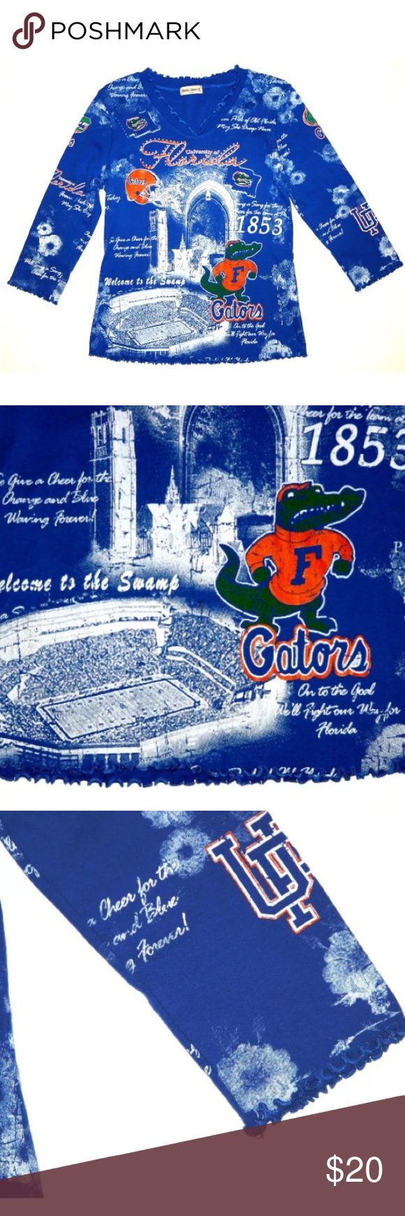 """University of Florida Gators Bling Shirt Small Ladies University of Florida Shirt with BLING! Size Small Made of 100% Cotton Small ruffles around the v-neck, cuffs and bottom Measures 17.5"""" across chest flat from underarm to underarm Sleeves are 3/4 length. Sleeves measure 17"""" from the shoulder seam down to the cuff The shirt is soooooo cute!!! No excessive signs of wear. Studio Gem Tops Tees - Short Sleeve"""
