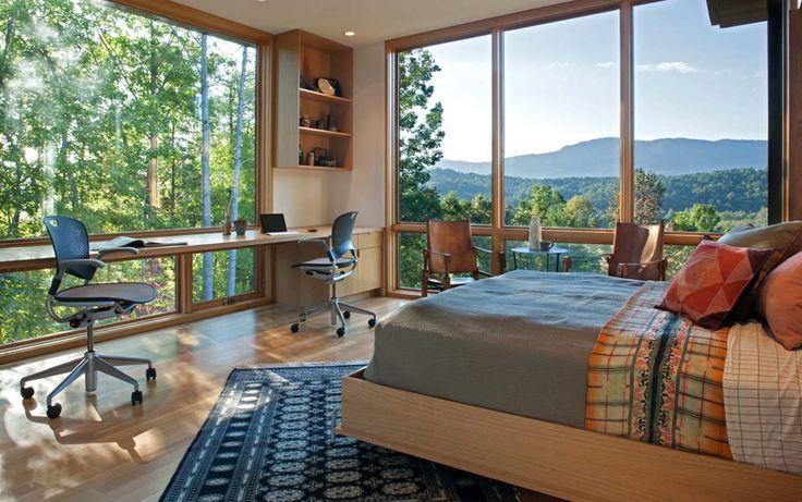 Modern lake house opens towards the Blue Ridge Mountains