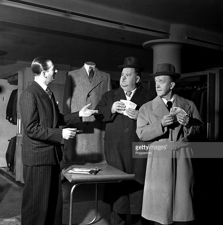 15th March 1947, American comedy duo Stan Laurel and Oliver Hardy pictured at menswear store in London's West End