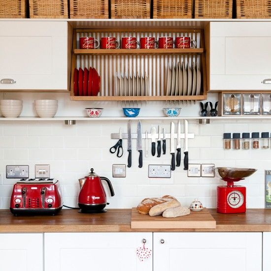 White kitchen with red accents. I especially like the small shelf that still gives room for cupboards above and knives, spices etc below.