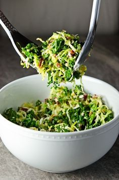 Kale and Brussels Sprouts Salad with Bacon and Pecorino - dressing (lemon juice, dijon mustard, shallot, garlic clove, kosher salt, black pepper, olive oil [would omit]), kale, brussels sprouts, turkey bacon, roasted almonds (might omit), Pecorino cheese #vegetarian #recipes #healthy #recipe #vegan
