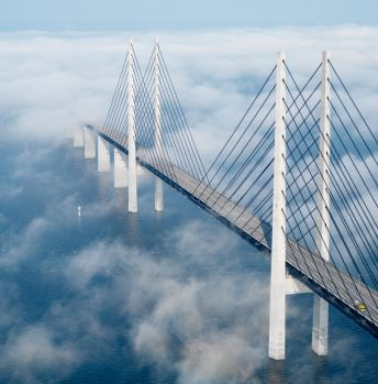Øresund / Öresund Bridge, a combined railway and motorway bridge across the Øresund strait between Sweden and Denmark (https://en.wikipedia.org/wiki/%C3%98resund_Bridge)