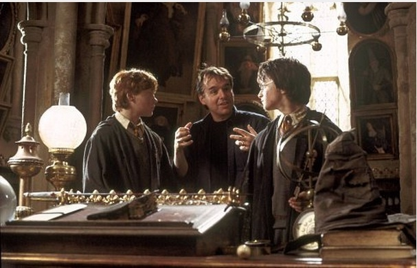 "Harry Potter and the Chamber of Secrets #18 / Director CHRIS COLUMBUS (center) on the set with DANIEL RADCLIFFE (right) and RUPERT GRINT in Warner Bros. Pictures' ""Harry Potter and the Chamber of Secrets""/ Warner Bros"