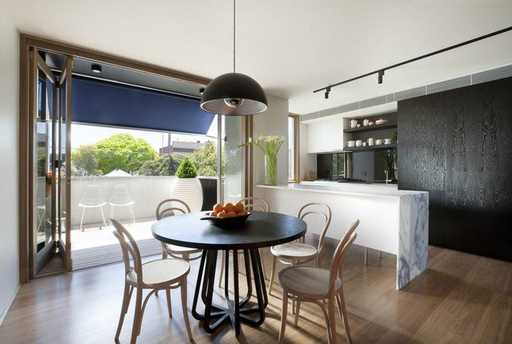 The Stella meals table in South melbourne home by NEOMETRO