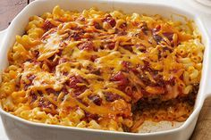 Find a casserole that wows with this Taco Bake Casserole! Mac and cheese and traditional taco ingredients are a match made in casserole heaven.