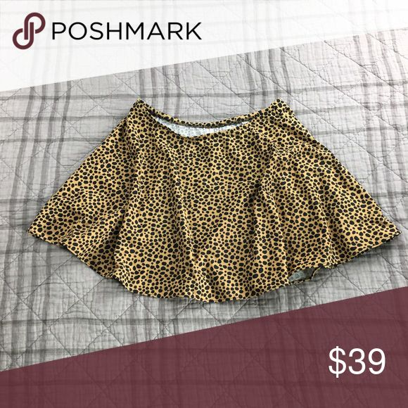 """Vintage Calvin Klein Swim Skirt WOMENS M     Vintage Swim Skirt in Animal Print by Calvin Klein Nylon/ Lycra Blend  Total Length:: 14: Waist:: 13"""" (flat) Hem:: (approx) 34""""  From a smoke free, pet free home Fast shipping from California No Trades  No Holds No Off Posh Transactions Reasonable Offers Accepted Calvin Klein Swim"""