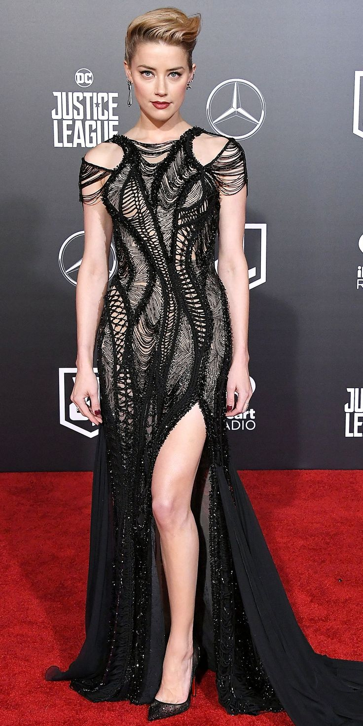 Look of the Day - Amber Heard from InStyle.com Amber Heard shut down the red carpet in a thigh-high slit gown by Atelier Versace. And we can't forget to mention those Christian Louboutin pumps, which were a perfect match.