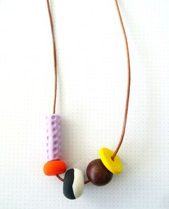 Minii necklacesMaterials: polymer clay, natural genuine leather cord, wooden beadDimensions: approx 80 cord (sizes may vary)Minii necklaces are sure to draw attention to any outfit with its strand of asymmetrical, vibrant and contrasting hand-formed beads that vary in texture, shape and size. Handmade with x4 hand-formed polymer clay and a wooden bead that have been threaded onto a durable, earthy toned leather cord. A mix of vibrant colours, shapes and textures to create the cutest and ...