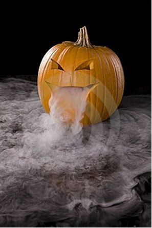 Put a container full of dry ice and water in a jack-o-lantern. To make it extra cool, add a glow stick to light up the fog.: