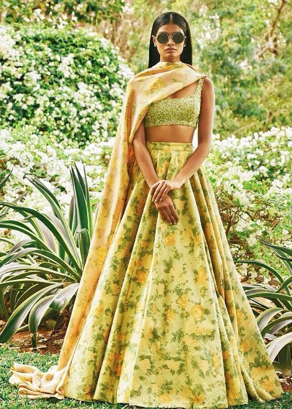 A modern floral lehenga by Sabyasachi. Shop for your dream wedding lehenga, with a personal shopper & stylist in India - Bridelan, visit our website www.bridelan.com #Bridelan #Sabyasachi