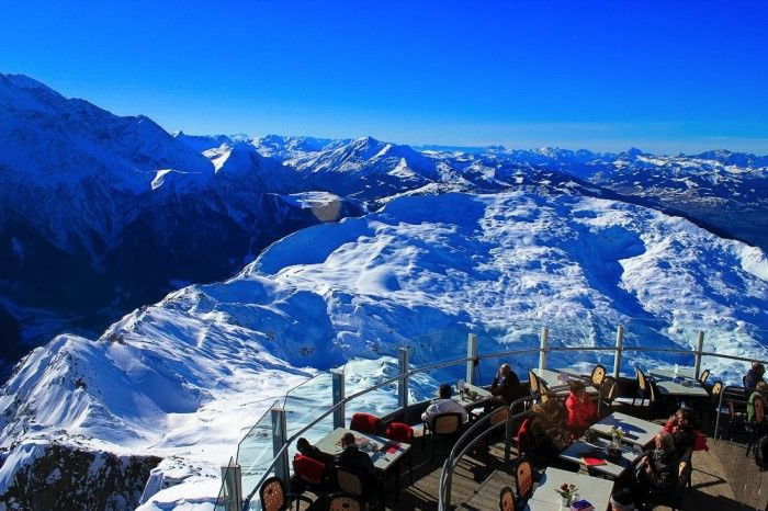 Stratosfare Bar, Queenstown, New Zealand - Queenstown's marvelous mountains are an adrenalin junkie playground year round, but don't worry, if you'd rather admire a mountain peak than climb, bike or ski it, the Stratosfare Bar is the spot for you. All you need to do to get there is ride one of the steepest cable cars in the world up 450 metres to Bob's Peak. Easy! Seriously though, the Skyline cable car safely delivers you to Stratosfare, a bar with 220 degree views out over Lake Wakatipu.
