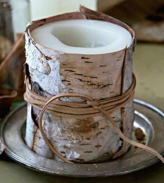 Check out Barbara's (justasmidgen.com) take on seasonal candles. She achieved picturesque rustic appeal by wrapping a store-bought candle with pretty birch bark and finishing it with leather string. A bunch of these dotting a holiday-theme mantel would feel cozy and bright./