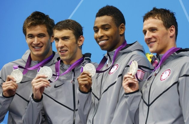 Nathan Adrian, Michael Phelps, Cullen Jones and Ryan Lochte of the U.S. pose with their silver medals in the men's 4x100m freestyle relay victory ceremony during the London 2012 Olympic Games at the A