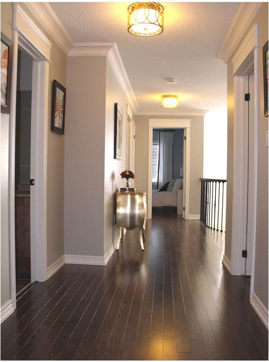 Love the dark flooring! Paint color: Benjamin Moore Revere Pewter