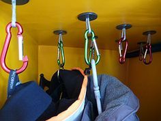 Hanging locker: A neat and light solution for a hanging locker: carabiners hung from Spectra loops   Read more at http://www.yachtingworld.com/blogs/elaine-bunting/a-work-of-art-7546#6U0oxES5YLjqHZZ3.